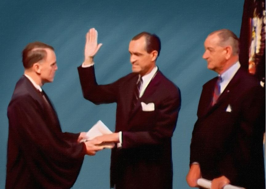 Richard Helms takes an oath at the his swearing in ceremony as Director of Intelligence.